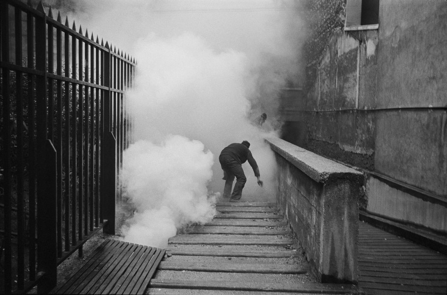 Alain Noguès - May 1968 students' uprising in France. - A demonstrator is caught in a cloud of tear gaz during the  May 1968 students' uprising in France. - protected by IMATAG
