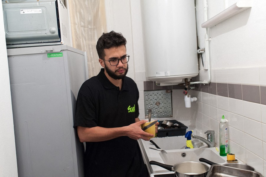 Julien Hazemann - MALIK WAKE UP AT 3am  - 3am. Malik just woke up to have a breakfast. He is observing Ramadan for a few days. - protected by IMATAG