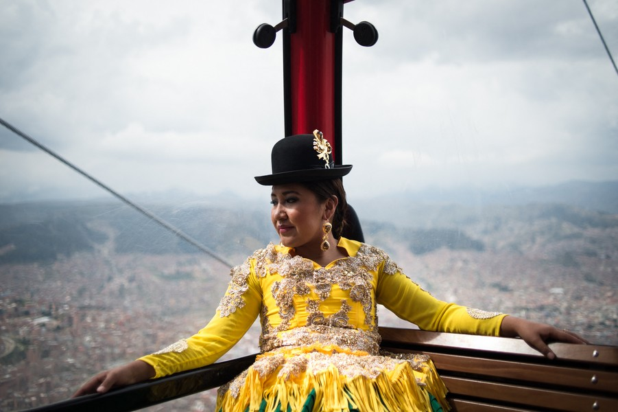 Delphine Blast - Gabriella - A young cholita looks at the city of La Paz from the top of a cabin of the cable car of the city, La Paz, Bolivia, April 22, 2017 - protected by IMATAG