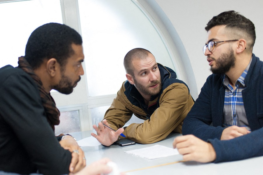 Julien Hazemann - THE STRIKE COMITEE MEETING - Thierry, Arnaud and Malik prepare a leaflet during a strike comity's meeting. - protected by IMATAG