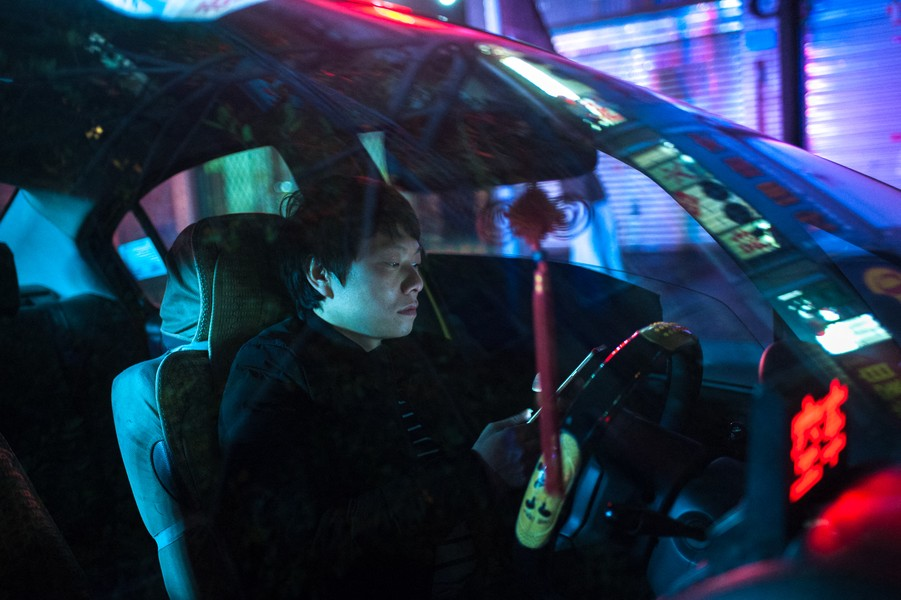 Julien Hazemann - THE MIN GONG TAXI DRIVER  - Li Xin, Wenyin's son has been a taxi driver for six years. He started working nights a year ago to earn a little bit more money. He rarely ma... - protected by IMATAG