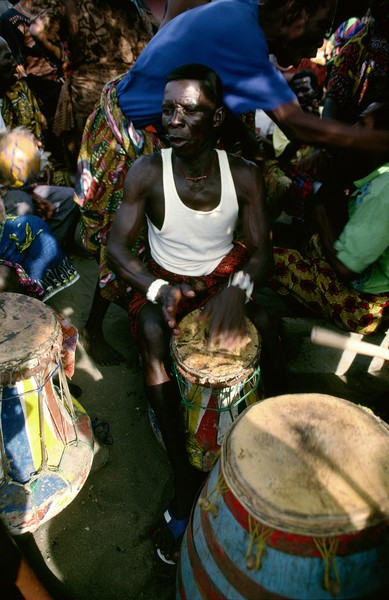 © Thierry Secretan - A drummer at a Ghanaian funeral - A traditionnal drummer during the wake-keeping of the chief fisherman of Pute, a village from the Eastern Region of Ghana, in 1992. - protected by IMATAG