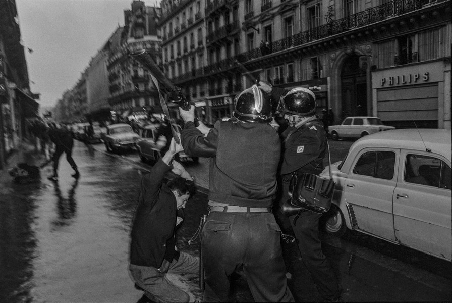 Alain Noguès - May 1968 students' uprising in France. - A demonstrator is beaten by two policemen with a riffle butt and a truncheon during the May 1968 student's uprising. - protected by IMATAG