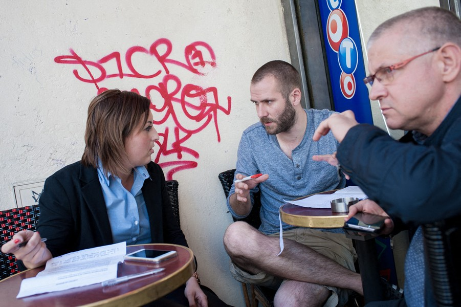 Julien Hazemann - ARNAUD HELPS A COLLEAGUES  - Arnaud and another CGT member, the main train workers' union on a café terrace near the train station help one of their colleagues in conflic... - protected by IMATAG