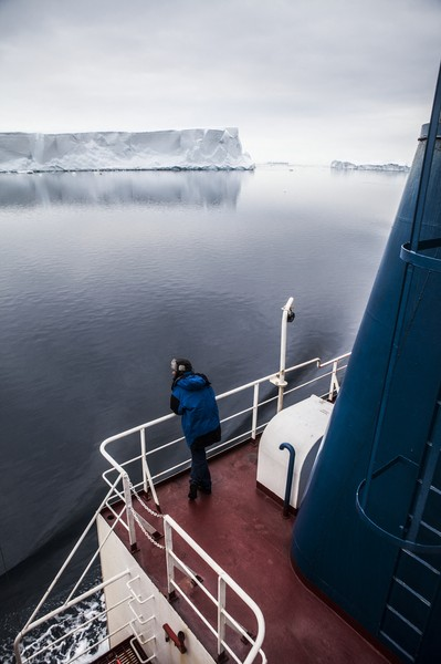 Francois Lepage/IP3 - Antarctica suplly convoy for Dumont D Urville Base and Concordia Research Station - Francois Lepage / IP3; Southern Ocean, Antarctica on February 16  2013 -  A passenger on the deck of the French L Astrolabe icebreaker and re... - protected by IMATAG