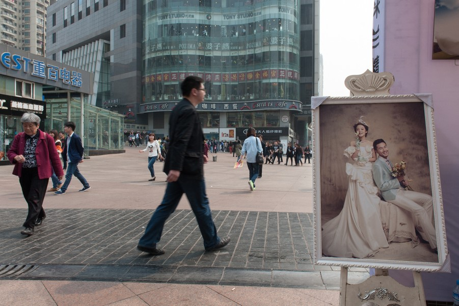 Julien Hazemann - FAMILY, THE UNSURPASSABLE HORIZON  - The promotional stall of a company specialized in wedding planning, set up in the very classy neighbourhood of Guanyinqiao. At a time where e... - protected by IMATAG