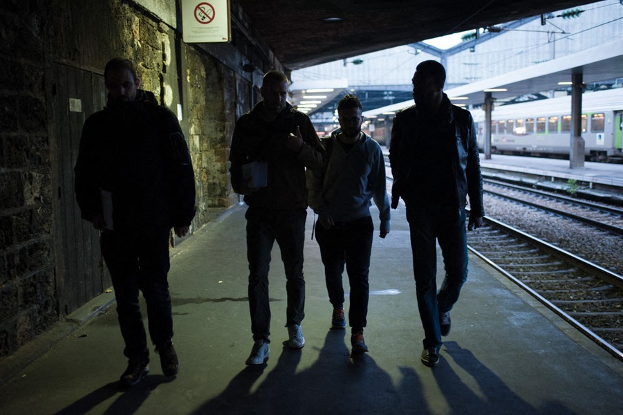 Julien Hazemann - THE BEGINNING OF THE ROUND OF THE STRIKERS - Remy, Arnaud, Malik and Theirry in the very early morning walking in the train station from one service to another to talk to their colleague... - protected by IMATAG