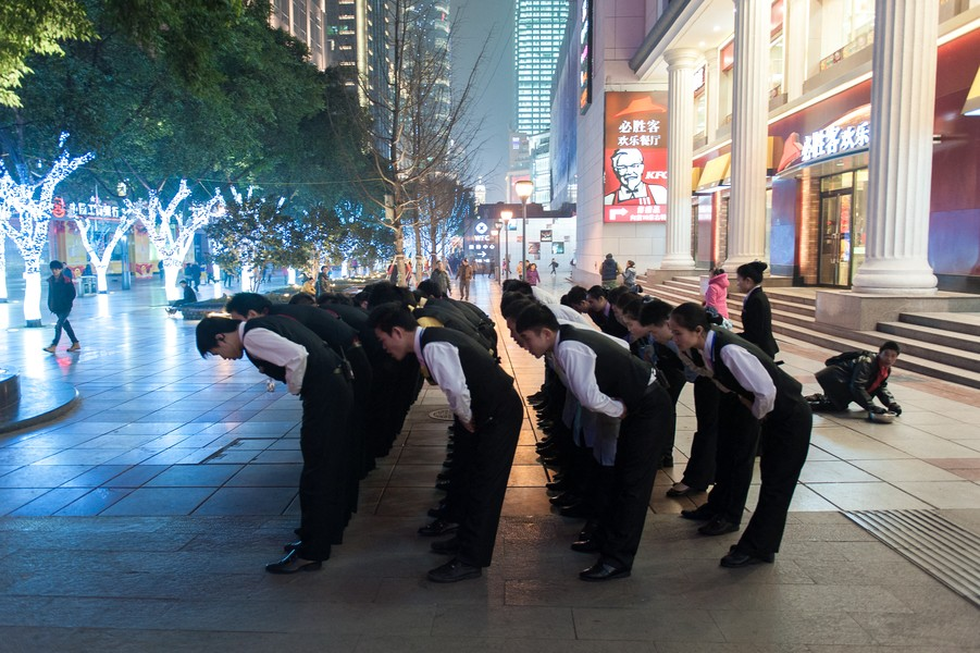 Julien Hazemann - THE SALUTE OF THE MIN GONG - Employees of one of Jie Fang Bei's Pizza Hut when they take their shift. Rural youth prefer waiter or cook jobs to work on construction sites... - protected by IMATAG