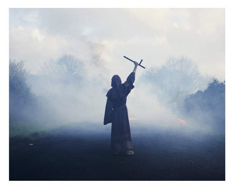 cyril zannettacci - A man in a cassock - A man in a cassock faces police in a cloud of tear gas grenades, he holds a tonfa police, thumb to the violent occupation of the police. - protected by IMATAG