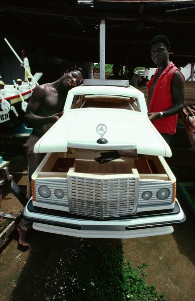 © Thierry Secretan - The Mercedes Benz coffin from Ghana - A Mercedes Benz coffin from the Kane Kwei workshop in Teshie, Ghana in 1987. The ultimate symbol of wealth the Benz coffin is reserved for th... - protected by IMATAG