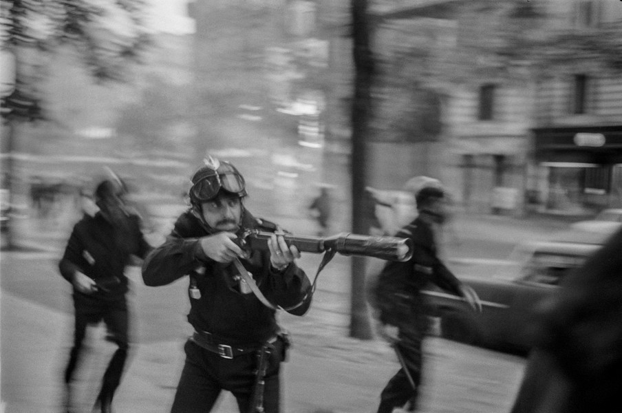 Alain Noguès - May 1968 students' uprising in France. - A policeman with a grenade launcher aims at demonstrators (a strictly prohibited maneuver) during the students' uprising in May 1968 in Paris. - protected by IMATAG
