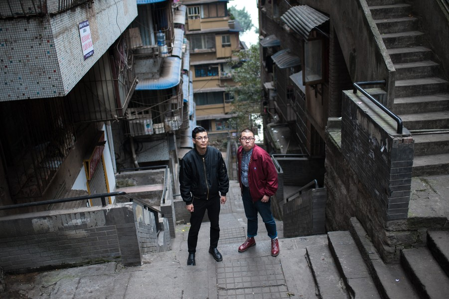 Julien Hazemann - UNDERGROUND CHONGQING  - Locke Dong and Ayu, in 2015, walking through the neighbourhood where they both grew up, next to Jie Fang Bei, back when it was still a workin... - protected by IMATAG