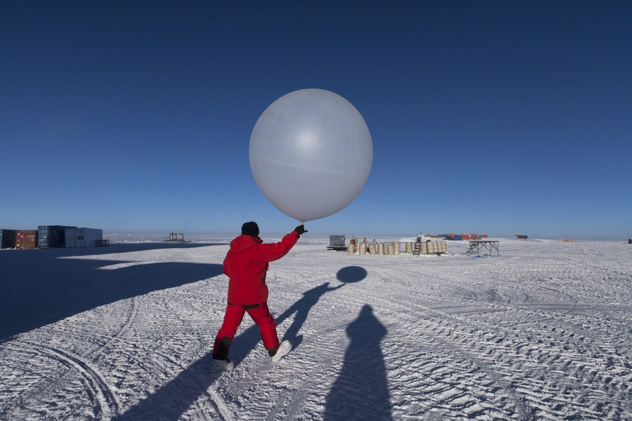 Francois Lepage/IP3 - Antarctica suplly convoy for Dumont D Urville Base and Concordia Research Station - Francois Lepage / IP3; Southern Ocean, Antarctica on February 16  2013 -   Scientist preparing to release weather balloon at the Concordia Re... - protected by IMATAG
